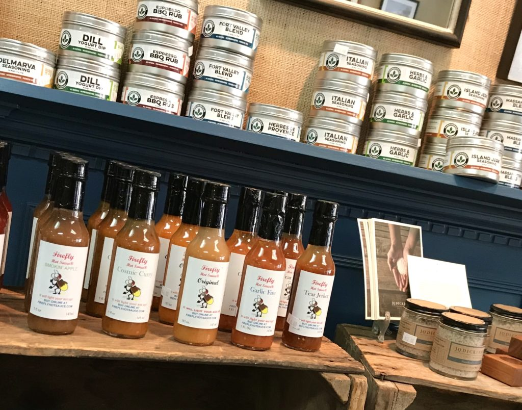 Spice Blends from The Shenandoah Spice Company and Firefly Hot Sauces filling the shelves at The Virginia Farmhouse