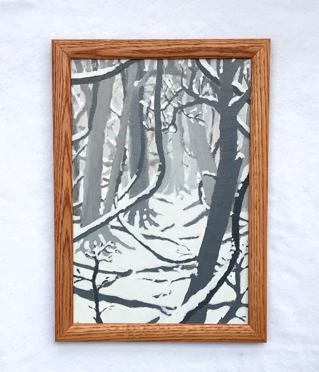 A painting of a snowy forest in a golden oak frame both hand made by MJ Seal