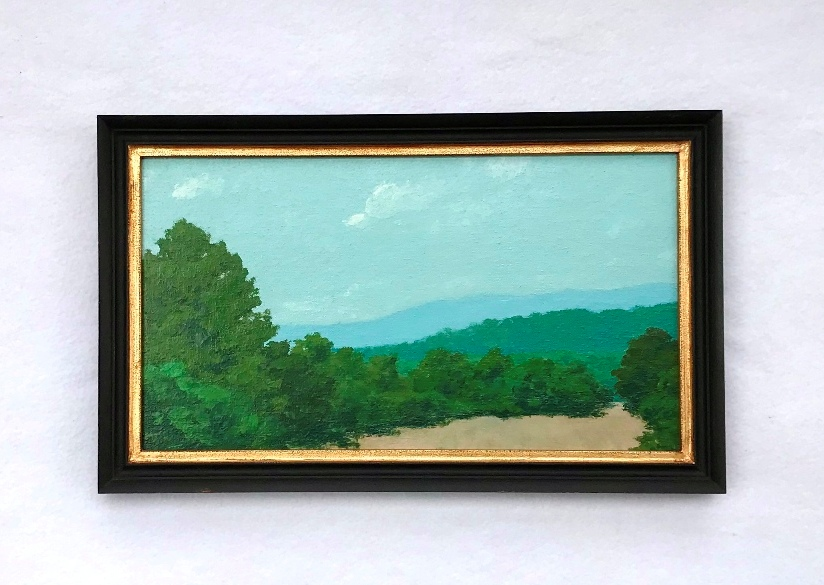 A painting of a Shenandoah Valley Landscape in a black and gold frame both made by MJ Seal