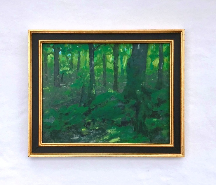 Painting of a forest in a gold and black cassetta-style frame both made by MJ Seal