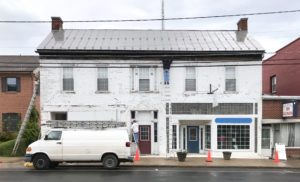 The Historic Fravel House in Downtown Woodstock is being repainted
