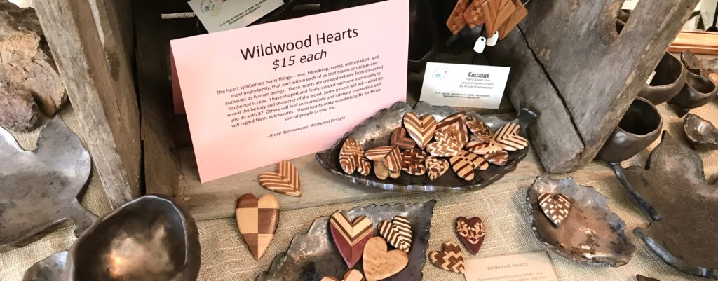 A plethora of Wildwood Hearts hand made from scraps of wood by Bruce Rosenwasser for sale at The Virginia Farmhouse