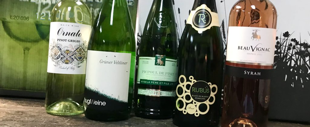 Bottles of Pinot Grigio, Gruner Veltliner, Picpoul, Rose de Syrah and Sparkling Whites Wines available at The Virginia Farmhouse