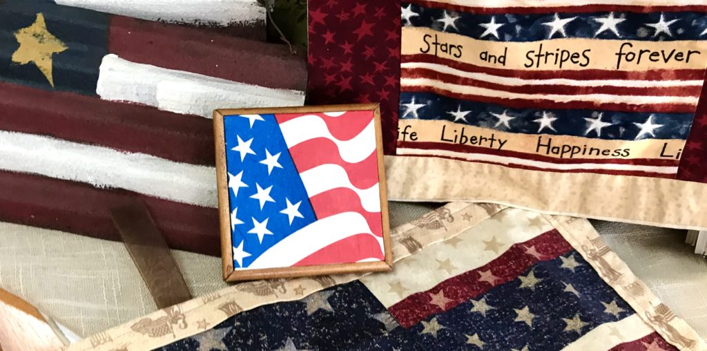 A variety of hand made US Flags and other July 4th regalia for sale at The Virginia Farmhouse