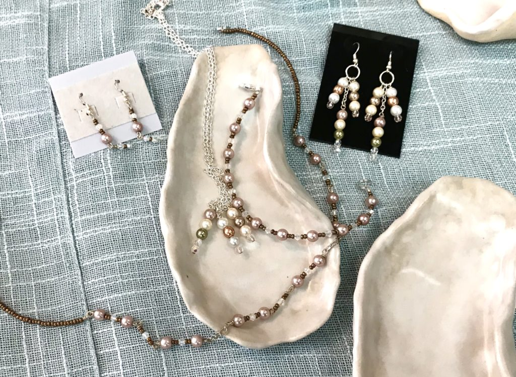 Two pearl beaded necklaces and two sets of earrings hand made by Sue Southee of Gemini Dreams available for sale at The Virginia Farmhouse