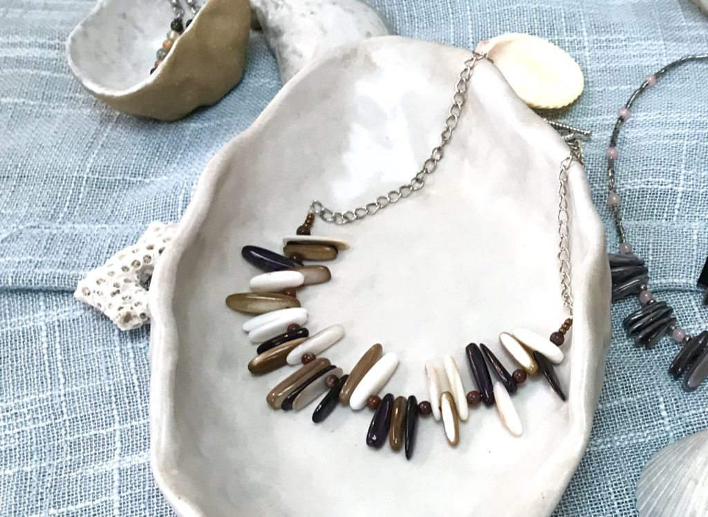 A white brown and black shell bead necklace hand made by Sue Southee of Gemini Dreams available for sale at The Virginia Farmhouse