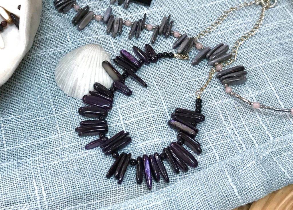 A purplish black shell bead necklace hand made by Sue Southee of Gemini Dreams available for sale at The Virginia Farmhouse