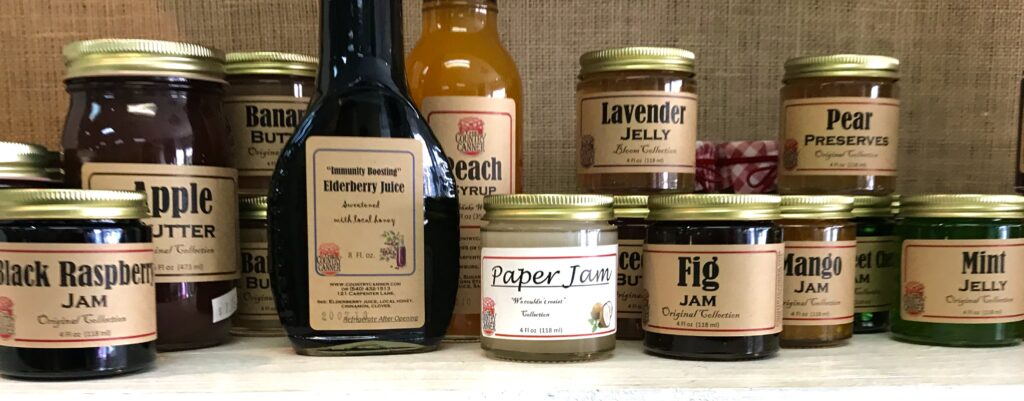 Jars of jellies and jams and bottles of Elderberry syrup frim The Country Canner available for sale at The Virginia Farmhouse