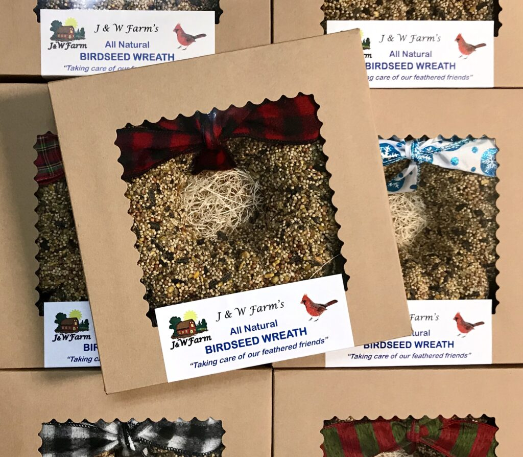 Birdseed wreaths from J & W Farm with plaid ribbons available for sale at The Virginia Farmhouse