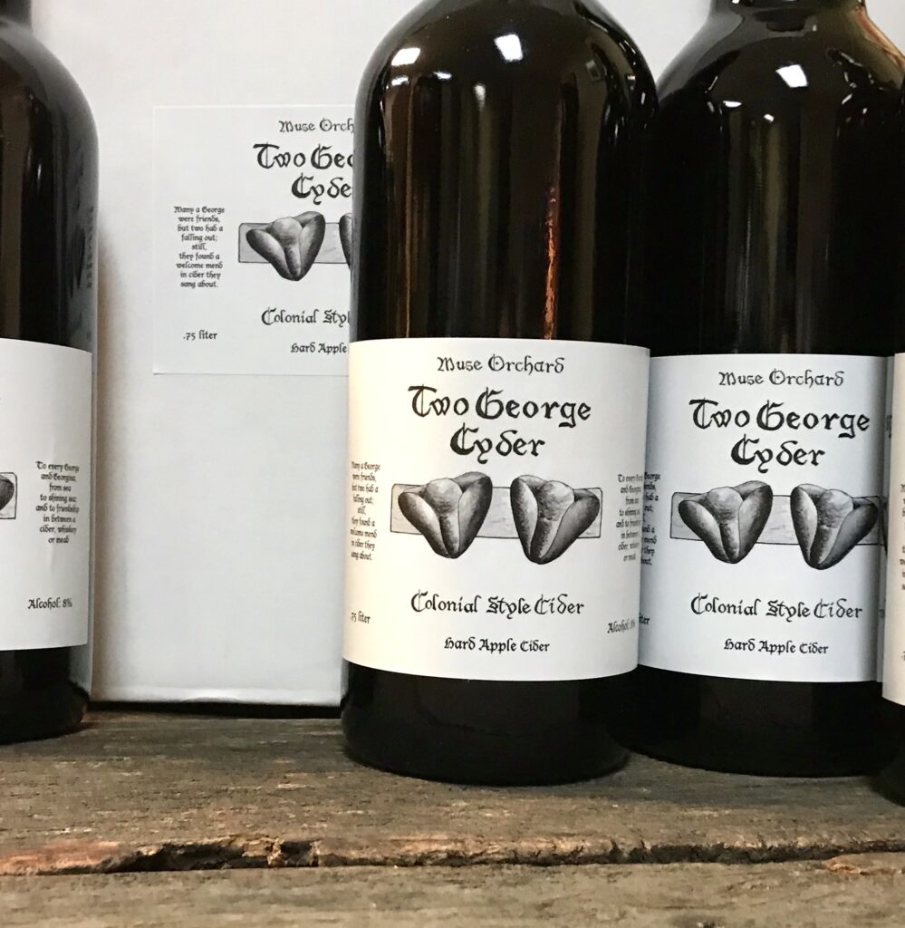 Bottles of Two George Cyder a colonial style hard cider from Muse Orchards available for sale at The Virginia Farmhouse