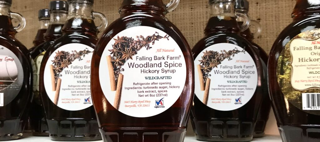 Bottles of Woodland Spice Hickory Syrup from Falling Bark Farm available for sale at The Virginia Farmhouse