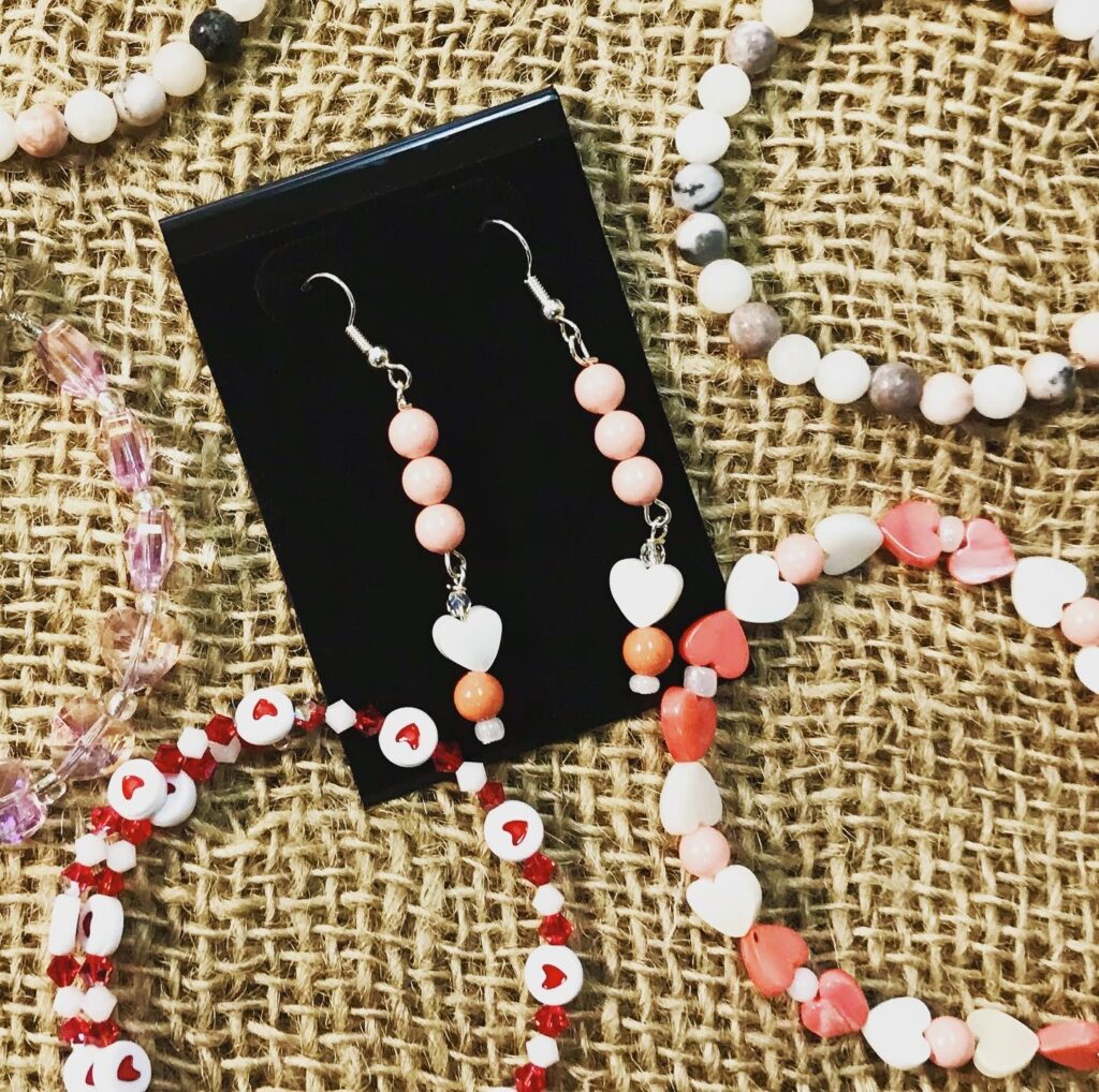 Beaded earrings and bracelets with heart patterns from Gemini Dreams available for sale at The Virginia Farmhouse