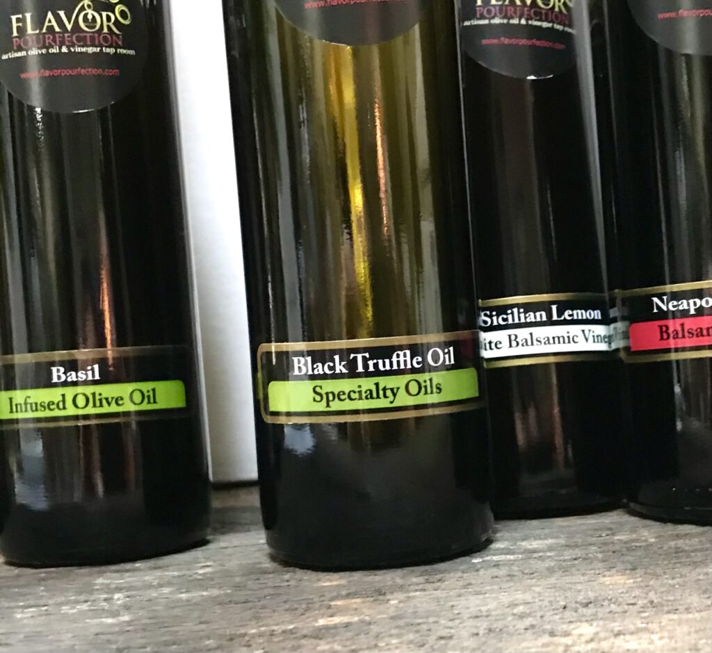 Bottles of Truffle oil and other infused oils and vinegars from Flavor Pourfection available for sale at The Virginia Farmhouse