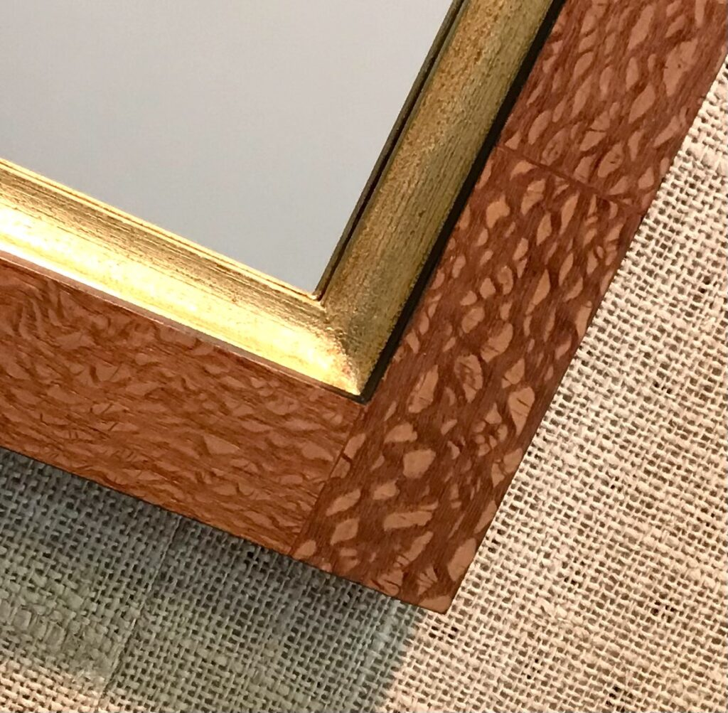 Close up detail of a picture frame hand made by MJ Seal veneered with lacewood available for sale at The Virginia Farmhouse
