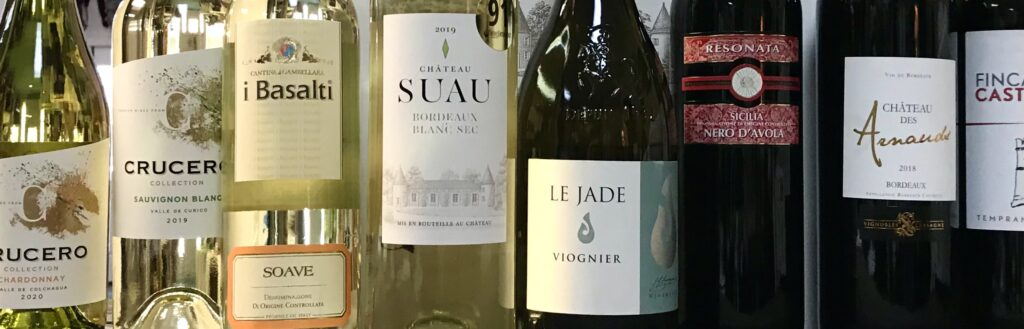 Bottles of Chateau Suau Bordeaux Blanc and other international wines available for sale at The Virginia Farmhouse