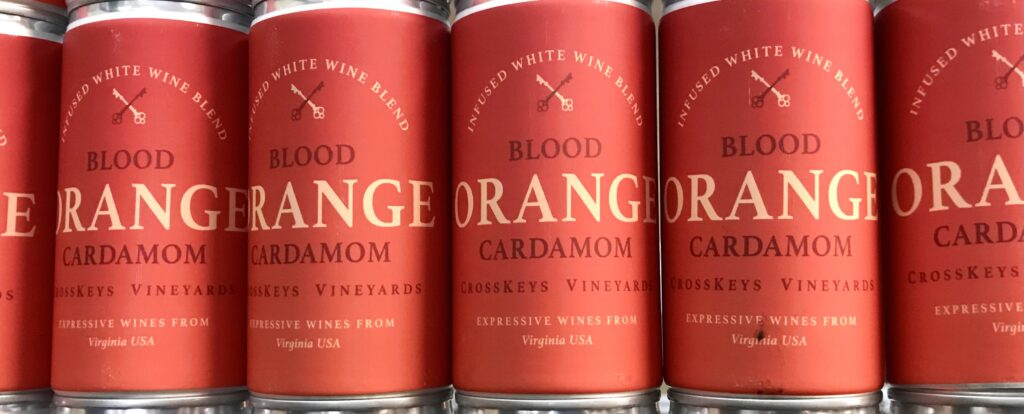 Cans of Blood Orange Cardamom infused wine from CrossKeys Vineyards available for sale at The Virginia Farmhouse