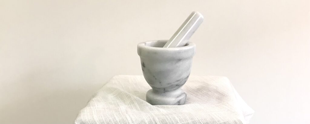A large white marble mortar and pestle available for sale at The Virginia Farmhouse