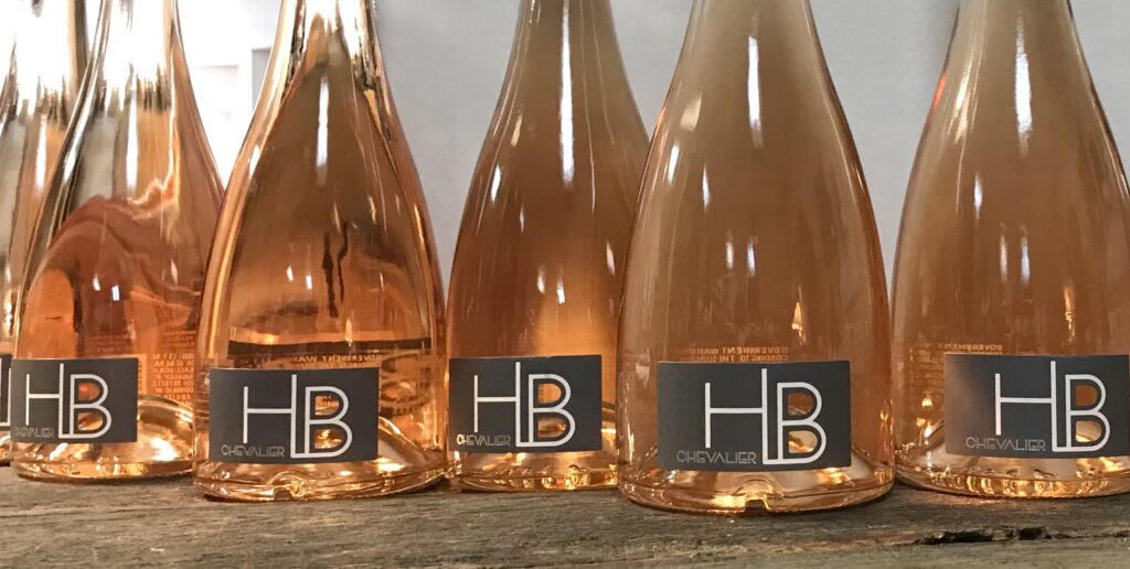 Bottles of H. B. Launguedoc Rose from France available for sale at The Virginia Farmhouse