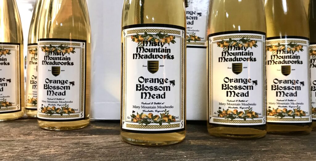 Bottles of Orange Blossom Mead from Misty Mountain Meadworks available for sale at The Virginia Farmhouse