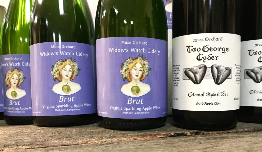 Bottles of Virginia Sparkling Apple Wine and Two George Cyder from Muse Orchard available for sale at The Virginia Farmhouse