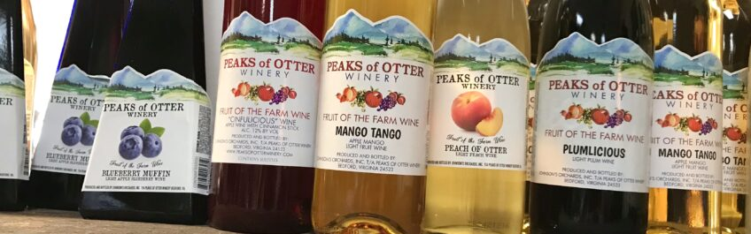 Bottles of various fruit wines from Peaks of Otter Winery available for sale at The Virginia Farmhouse
